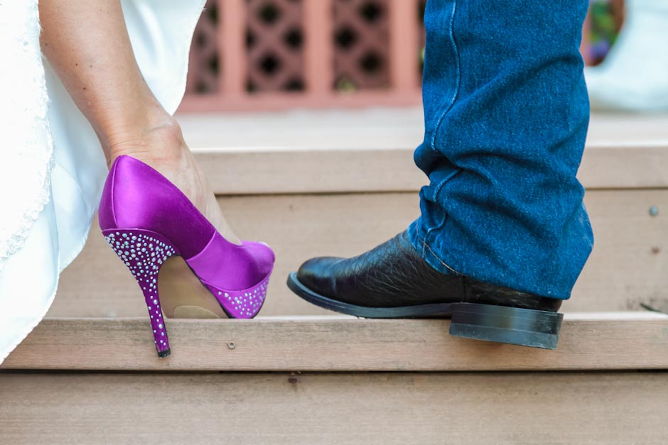 Cowboy boots and high heels on the newlyweds