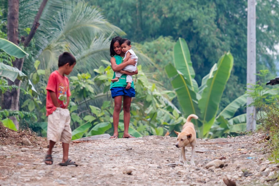 Children play in the road outside Iligan, Mindanao, Philippines